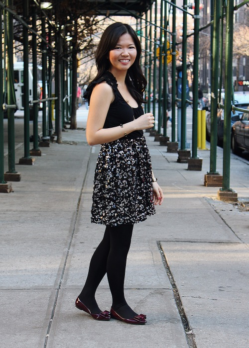 Jenny in Jacquard; NYC fashion blogger; style blog; outfit photos; Forever 21 black short sleeve top; Joe Fresh black sequin skirt; Kate Spade gold necklace; Uniqlo HeatTech leggings; ShoeMint Hillary bow flats in patent wine oxblood shoes; Juicy Couture pyramid pave stretch bracelets; C. Wonder skinny calf hair bangle