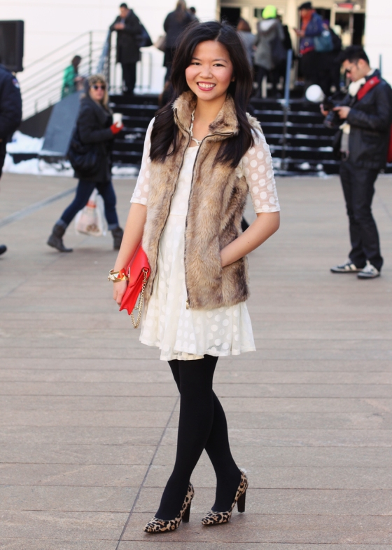 Skirt the Blog; NYC fashion blogger; style blog; Valentine's Day outfit photo; Lulu's white polka dot dress; Zara Girl faux fur vest; Sequin pave branch necklace; C. Wonder red saffiano gold tab-lock clutch; H&M black tights; DVF April leopard heels; Juicy Couture gold cufe