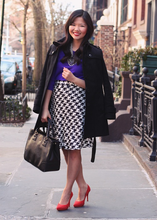 Skirt The Rules Blog; NYC fashion blogger; style blog; winter to spring outfit photo; J.Crew Tippi purple sweater; Banana Republic black wool trench coat; Spike The Punch Addison crystal statement necklace; Banana Republic Factory houndstooth skirt; Pour La Victoire Daina red suede pump; Tory Burch Robinson black satchel tote