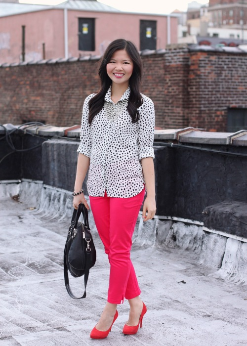 Skirt The Rules Blog; NYC fashion blogger; style blog; pink and red outfit photo; H&M black and white spot shirt; H&M hot pink capri pants; Spike The Punch Addison rhinestone statement necklace; Botkier Howard black satchel; A Beautiful Heart bubblegum black stretch bracelet; Pour La Victoire red suede pumps