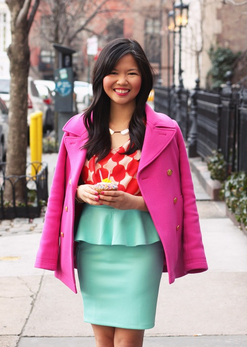Skirt The Rules Blog; NYC fashion blogger; style blog; spring outfit photo; J.Crew hot pink Majesty stadium-cloth coat; Anthropologie orange pattern blouse; Forever 21 mint peplum skirt; Pour La Victoire Mai wedge pump in nude; C. Wonder snake skin skinny bangle; BaubleBar geometric bronze necklace; Crumbs birthday cupcake