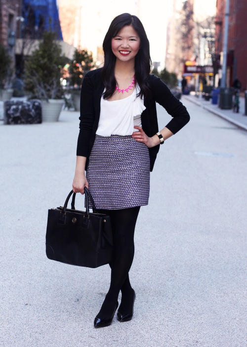 Skirt The Rules Blog; NYC fashion blogger; style blog; outfit photos; Zara black v-neck cardigan; Forever 21 bow blouse; J.Crew purple silver tweed mini-skirt; H&M black tights; Tory Burch Robinson tote; Bauble Bar fuschia tab strand necklace; Juicy Couture pave pyramid stretch bracelet