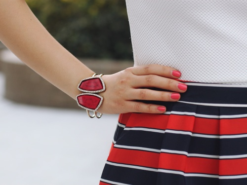Skirt The Rules Blog; NYC fashion blogger; style blog; spring outfit photos; H&M cream structured shoulder top; J.Crew Factory red and navy striped skirt; Juicy Couture statement necklace; gemstone cuff bracelet; Kate Spade City Sidney Striped tote bag; Pour La Victoire Mai wedge; J.Crew pave square link bracelet