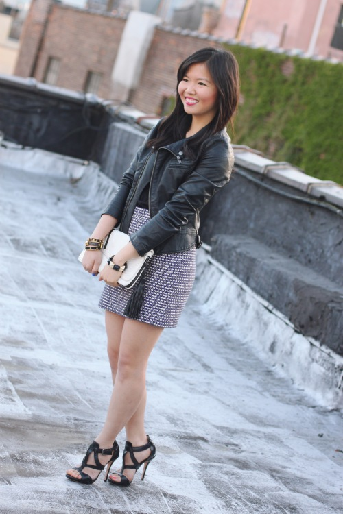 Skirt The Rules Blog; NYC fashion blogger; style blog; spring outfit photos; faux vegan leather moto jacket; H&M black v-neck t-shirt; J.Crew purple silver tweed mini skirt; L.A.M.B. black and white clutch; L.A.M.B. black strappy heels; Juicy Couture pave black stretch bracelet; C. Wonder black skinny cuff