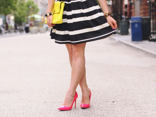 Skirt The Rules Blog; NYC fashion blogger; style blog; spring outfit photo; black and white striped dress; J.Crew Factory Vero neon yellow clutch; ShoeMint hot pink pointed pumps; Juicy Couture pave pyramid stretch bracelet; C. Wonder skinny bangles; Crown and Glitter black and gold spike necklace; BaubleBar bronze geometric necklace