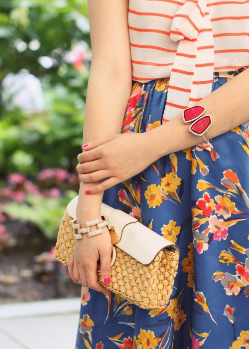 Skirt The Rules Blog; NYC Fashion Blogger; style blog; summer outfit photos; four ways to wear florals and stripes; how to mix prints; Banana Republic striped pussy bow top; Anthropologie floral midi skirt; Michael Kors white leather straw clutch; J.Crew pave square link bracelet; red gemstone bracelet; Sam Edelman Sophie colorblock wedges