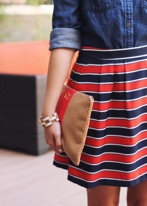 Skirt The Rules Blog; NYC fashion blogger; style blog; fall outfit photos; Banana Republic dark chambray denim shirt; J.Crew Factory red and navy striped skirt; J.Crew square pave link bracelet; C. Wonder camel and red striped clutch; H&M gold brown captoe shoes