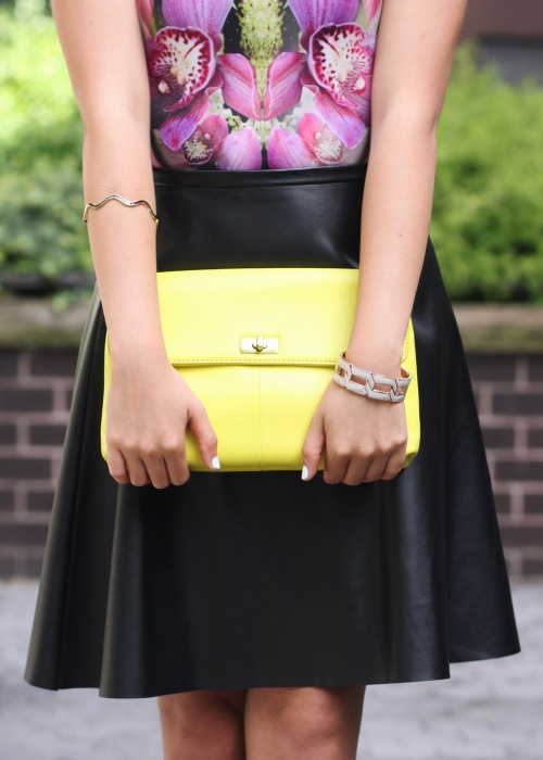 Skirt The Rules Blog; NYC fashion blogger; style blog; fall outfit photo;  Le Tote mirrored floral dress worn as top; Kirna Zabete x Target leather a-line skirt; BaubleBar black geometric statement necklace; J.Crew Factory Vero neon yellow clutch; L.A.M.B. black cut out heels