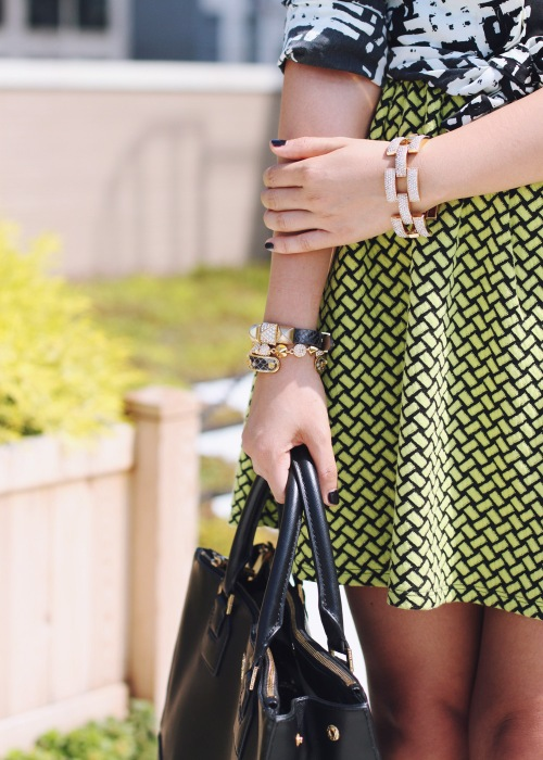 Skirt The Rules Blog; NYC fashion blogger; style blog; fall outfit photo; how to mix prints for fall; Rachel by Rachel Roy graphic print blouse; Forever 21 neon black textured dress; Tory Burch Robinson satchel tote; Juicy Couture pave pyramid leather bracelet; C. Wonder snakeskin skinny bangle cuff; CC Skye Mercy Princess bracelet; J.Crew pave square link bracelet; L.A.M.B black strappy heels